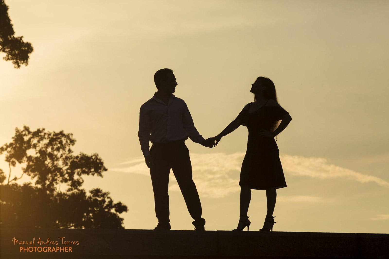 silhouette couple during sunset at engagement session