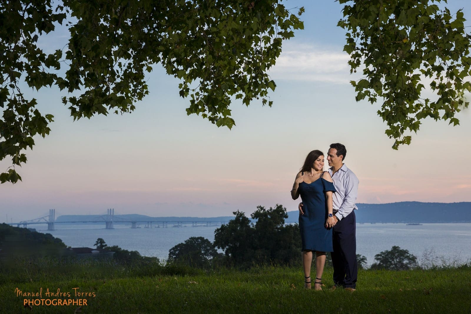 couple posing in front of landscape during engagement session