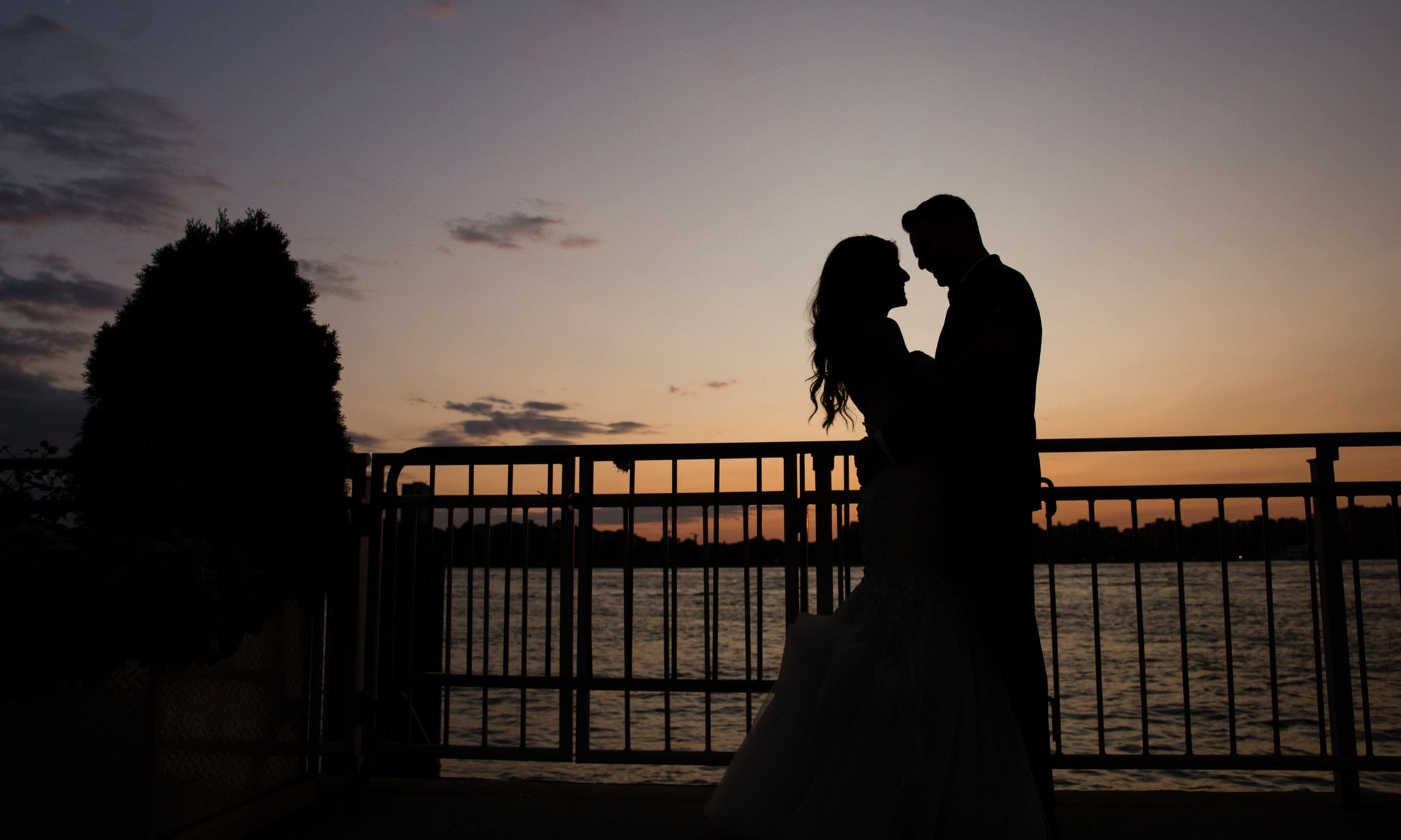 couple silhouette at sunset on wedding day