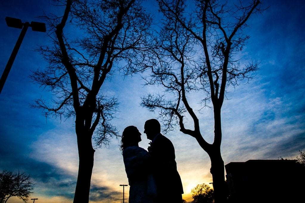 Bride and groom silhouette during Sunset at Glenn island wedding