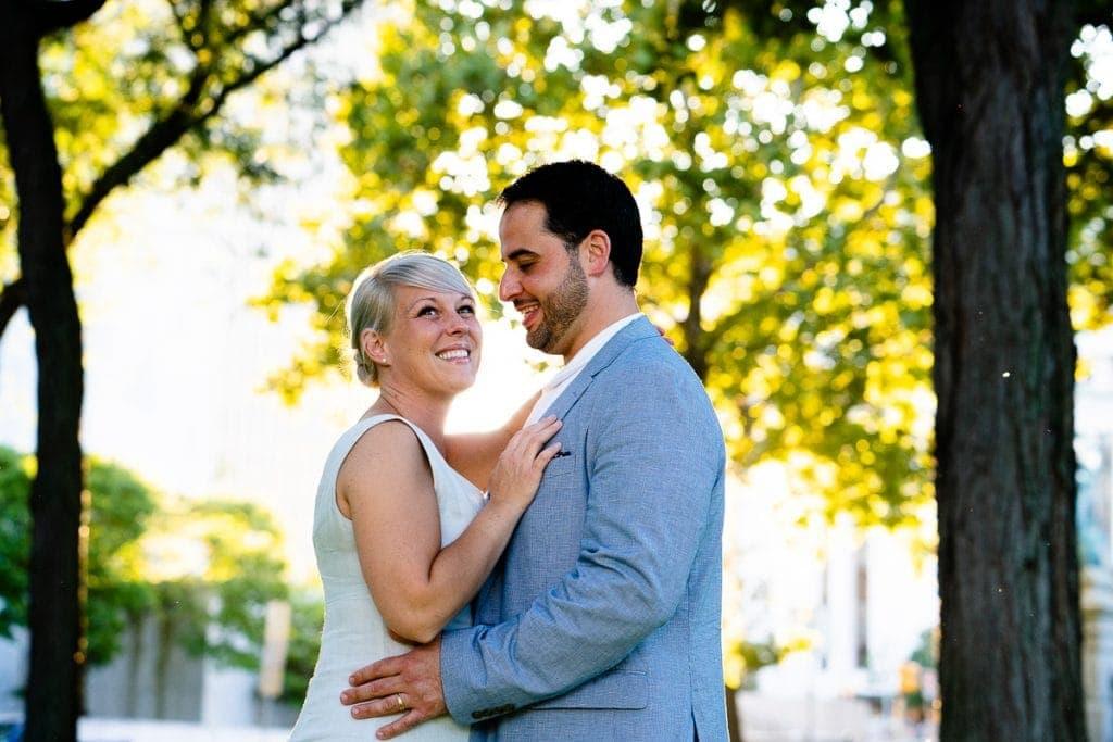 bride and groom portrait sun behind