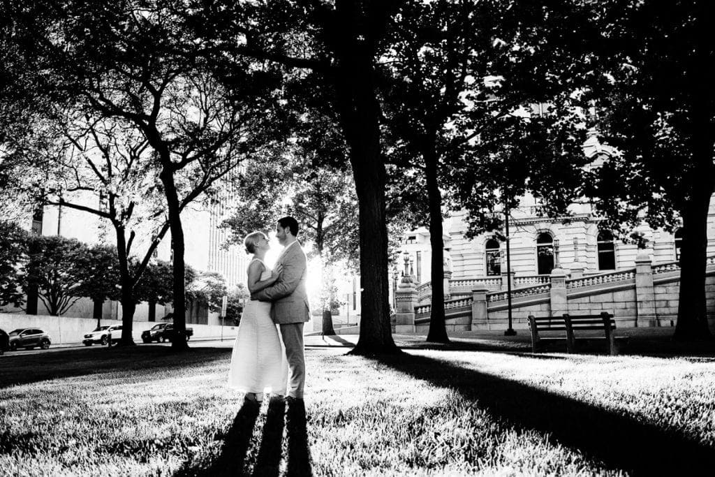 black and white image of bride and groom during sunset