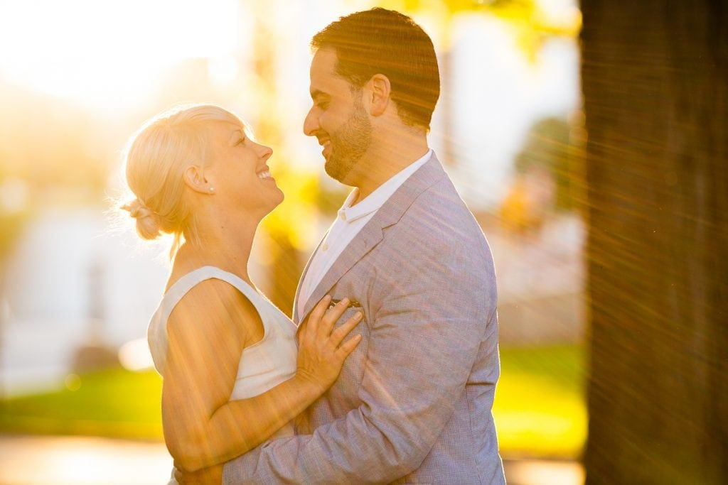 couple looking at each other sunray behind them