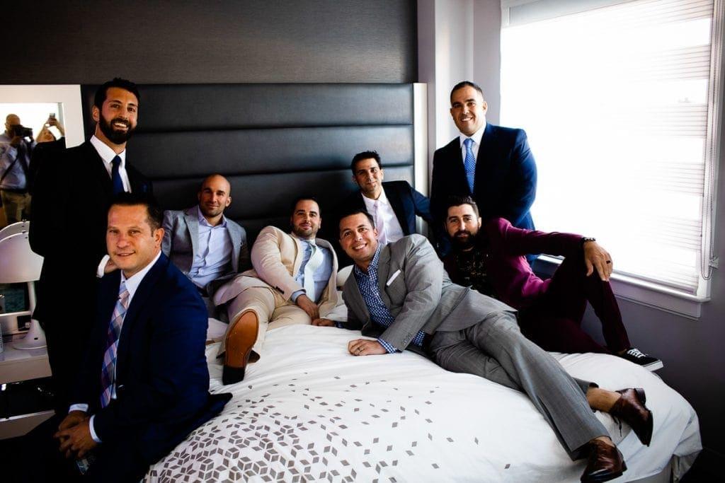 groomsmen portrait on bed during wedding day