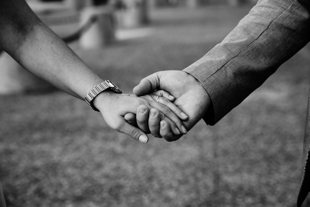 close up of couple holding hands